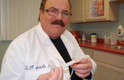 врач занимающийся раком